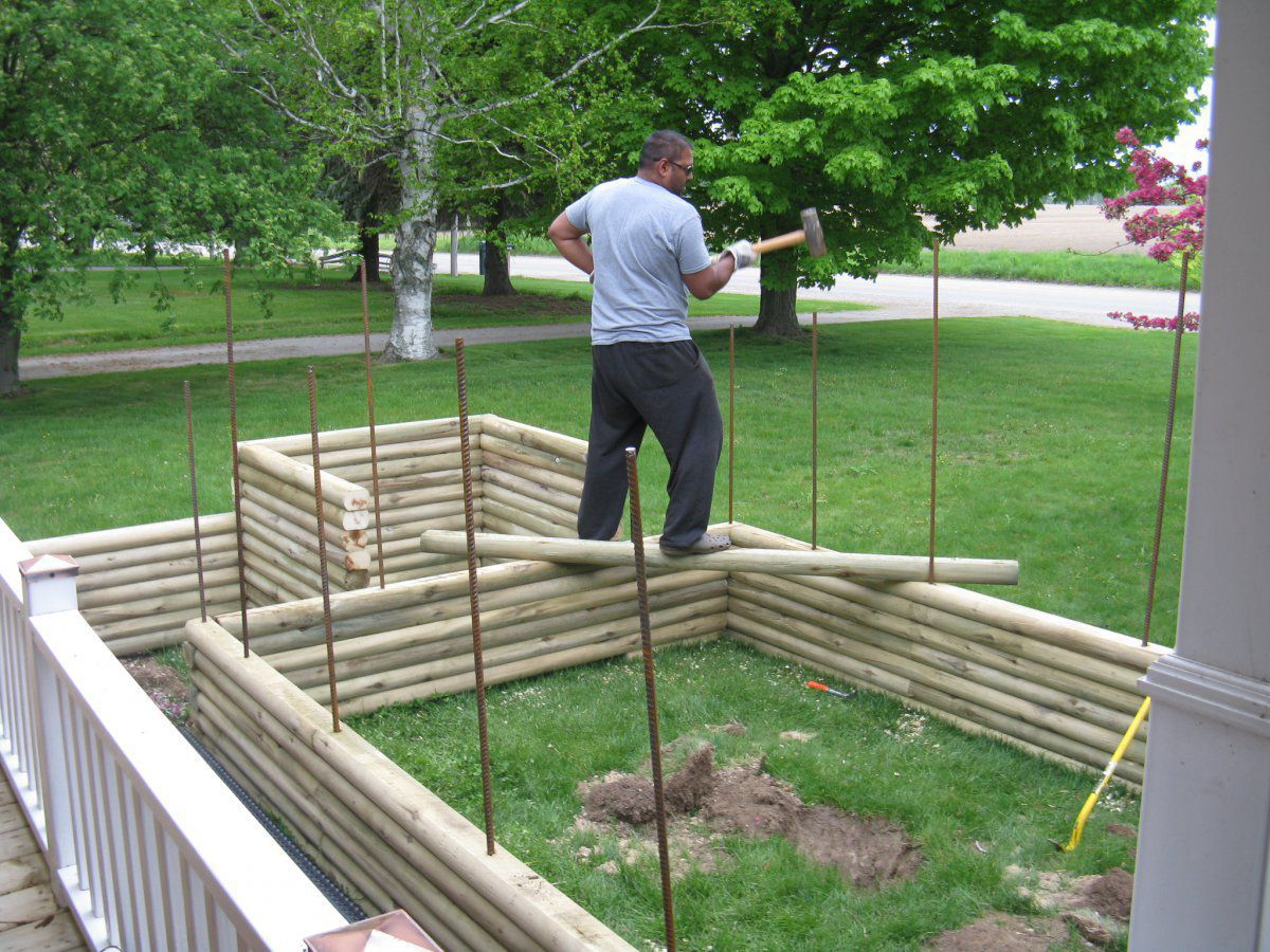 Pics of my partial above below ground pond garden for Above ground koi pond construction