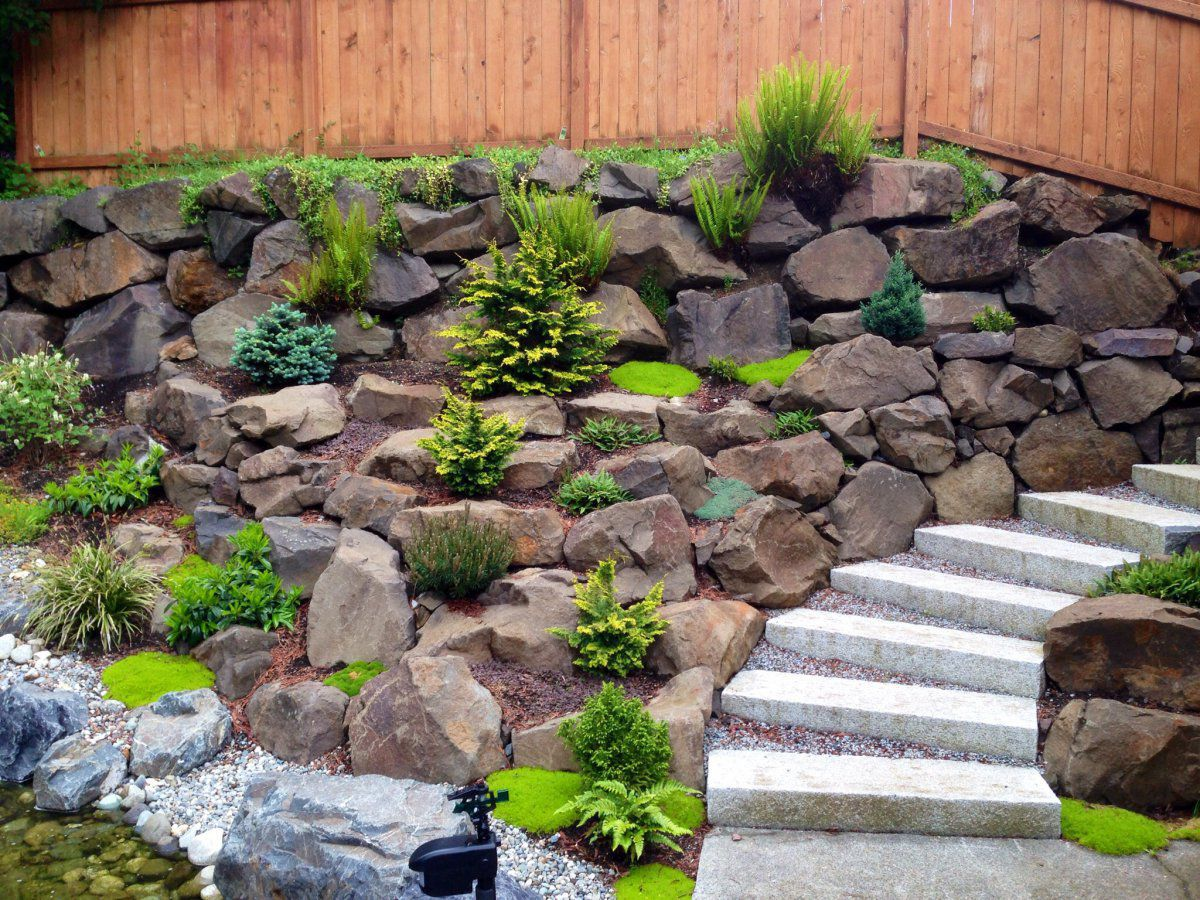 How to secure a retaining wall around a hillside pond for Garden pond rockery ideas